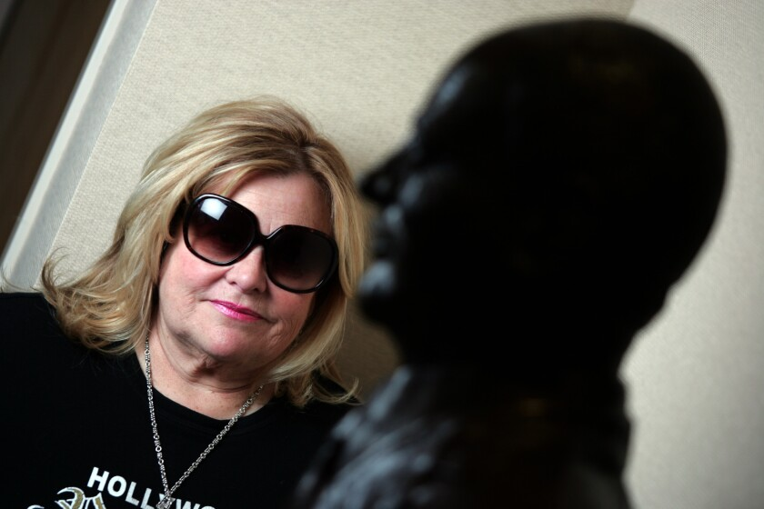 Francesca Hilton stands behind a statue of her father, Conrad Hilton, at the office of the Hilton Family Foundation in Century City in 2007.