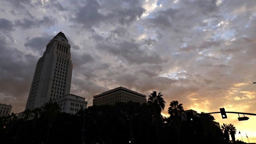 LOS ANGELES, CA - OCTOBER 28, 2016 - The sun rises over city hall in downtown Los Angeles, Friday Oc