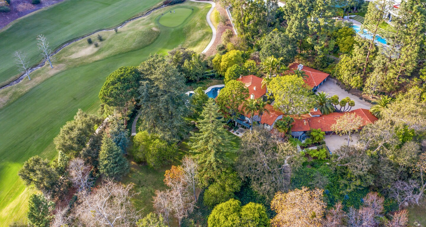 Built in the '50s by Gerard Colcord, the 2.5-acre spread includes a Mediterranean-style villa and guesthouse surrounded by lawns, gardens and paths.