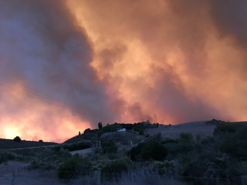 Smoke fills the sky as Alisal's fire burns in the distance