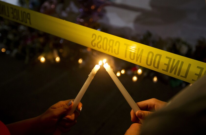 A candlelight vigil is held outside Emanuel AME Church in Charleston, S.C., where nine people were slain during Bible study a night earlier at the historic black church.