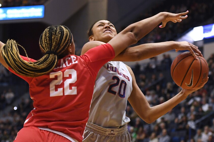 Houston's KeAsja Peace (22) fouls Connecticut's Olivia Nelson-Ododa (20) in the first half of an NCAA college basketball game, Saturday, Jan. 11, 2020, in Hartford, Conn. (AP Photo/Jessica Hill)