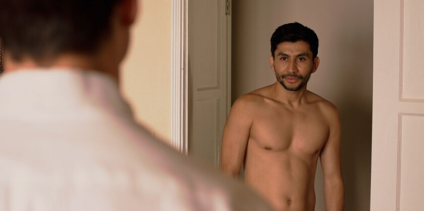 "A bare-chested René Mena in the movie ""Prescience."""
