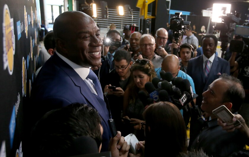 Magic Johnson, the Lakers' president of basketball operations, talks with reporters during media day at the team's new training facility in El Segundo.