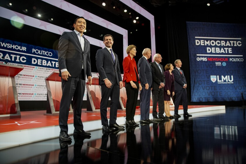 Democratic presidential candidates take the stage at Loyola Marymount University in Los Angeles before their Dec. 19 debate.