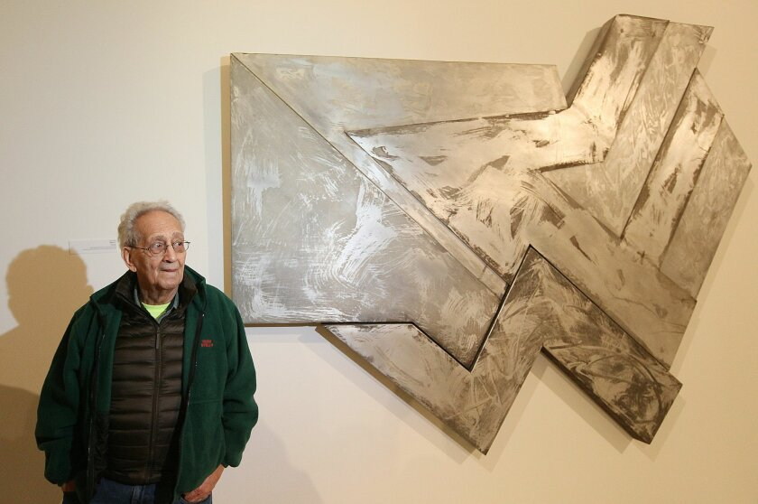 "U.S. artist Frank Stella poses in front of one of his works at an exhibition devoted to him in Warsaw, Poland, Thursday, Feb. 18, 2016. ""Frank Stella and the Synagogues of Historic Poland"" opens Friday at the POLIN Museum of the History of Polish Jews and will run through June 20. It showcases abst"