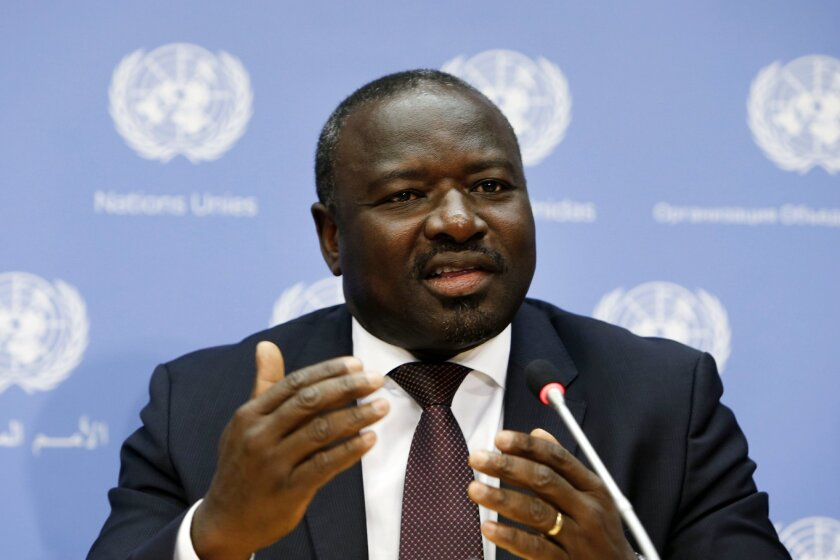 """FILE - In this Sept. 27, 2013 file photo, the Comprehensive Nuclear Test Ban Treaty Executive Secretary Lassina Zerbo speaks during a news conference during the 68th session of the United Nations General Assembly at U.N. headquarters. Lerbo says arch-enemies Iran and Israel are """"the closest"""" of the eight holdout nations to ratifying the treaty and assuring the world they will never conduct a nuclear test explosion.(AP Photo/Jason DeCrow)"""