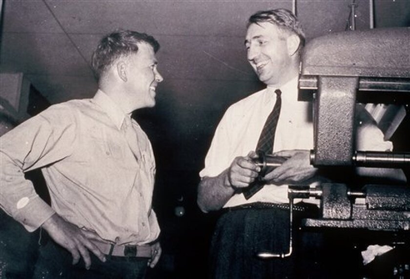 FILE - This is an undated photo from the 1940's of William Hewlett, left, and David Packard, who co-founded Silicon Valley electronics company Hewlett-Packard Co. in 1938, running it out of their Palo Alto, Calif., garage at the end of the Great Depression. (AP Photo/HO/Hewlett Packard, File)
