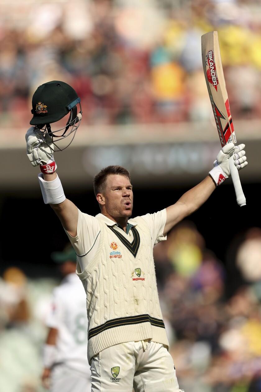 Australia's David Warner celebrates his 300 during their cricket test match against Pakistan in Adelaide, Saturday, Nov. 30, 2019. (AP Photo/James Elsby)