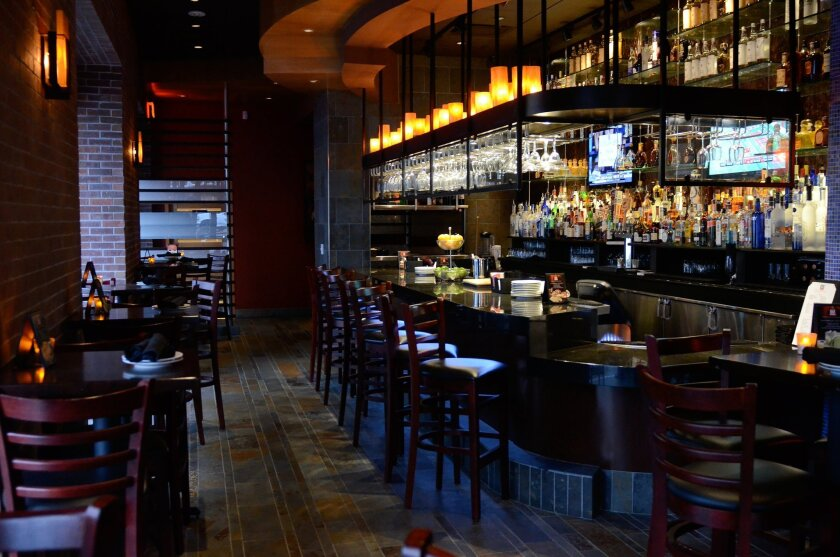 Guests can enjoy happy hour and small plates in Fogo de Chao's bar.