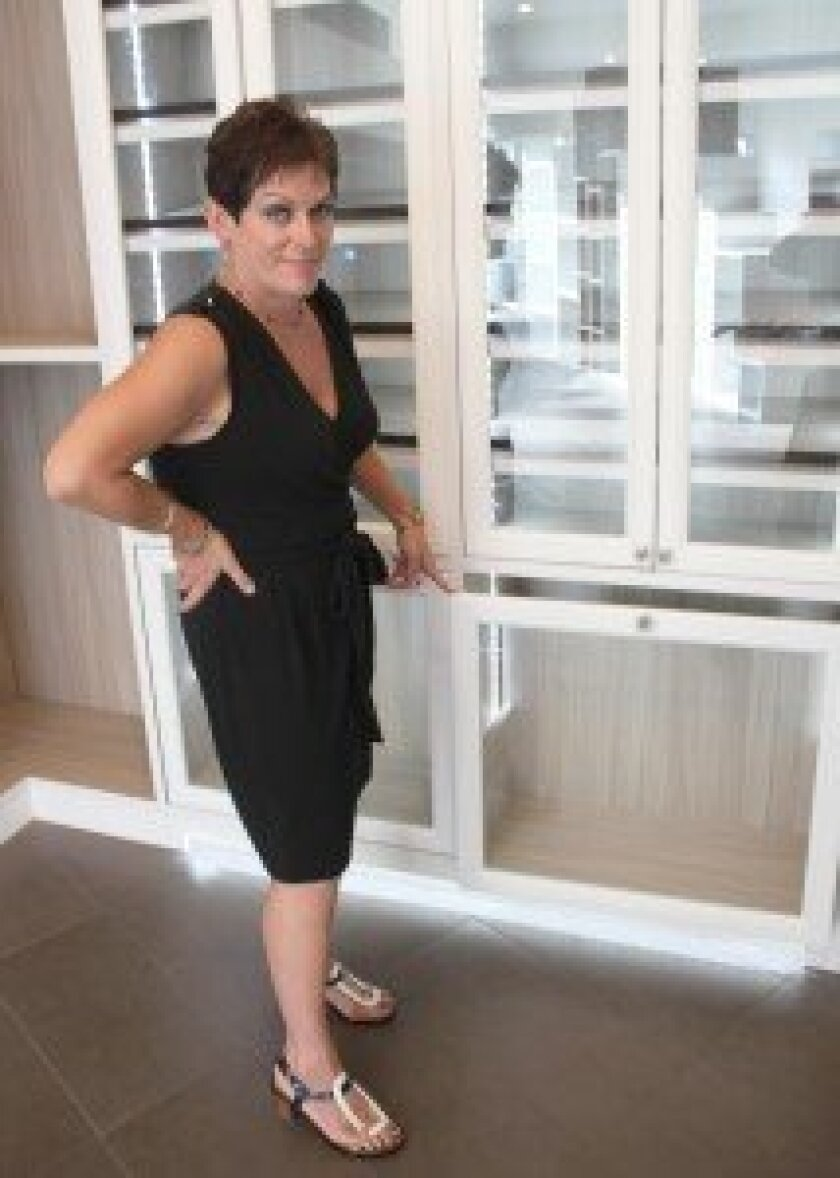 Margaret Kres, California Closets' director of sales and marketing, offers a tour of the new showroom at 7603 Girard Ave.