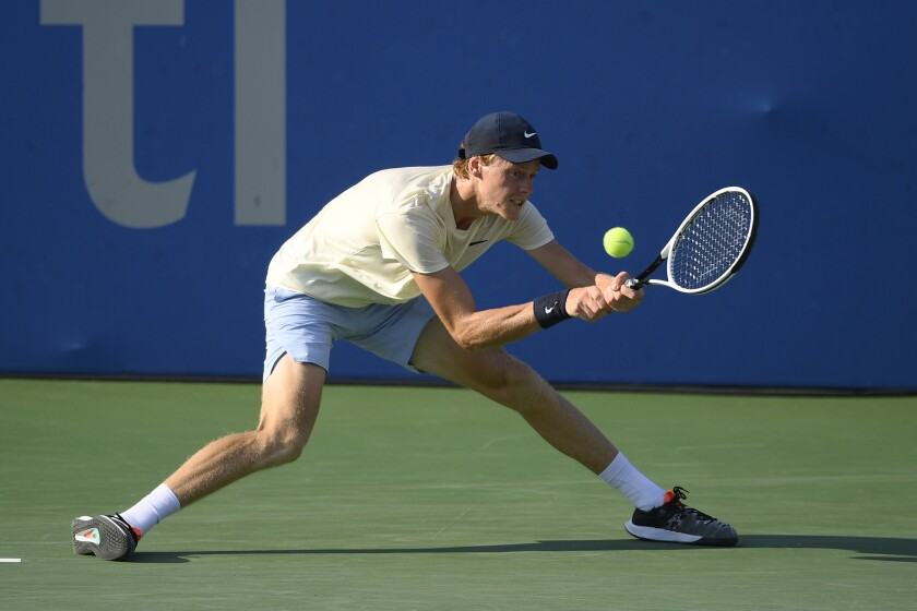 Jannik Sinner, of Italy, returns a shot against Mackenzie McDonald, of the United States, during the singles final at the Citi Open tennis tournament Sunday, Aug. 8, 2021, in Washington. (AP Photo/Nick Wass)