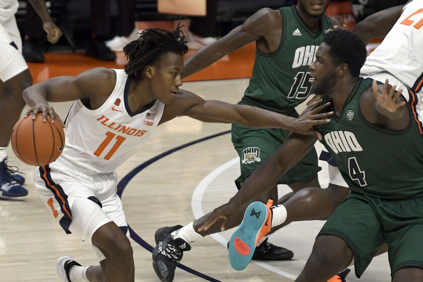 Illinois' Ayo Dosunmu (11) pushes past Ohio's forward Dwight Wilson III (4) during the first half of an NCAA college basketball game Friday, Nov. 27, 2020, in Champaign, Ill. (AP Photo/Holly Hart)