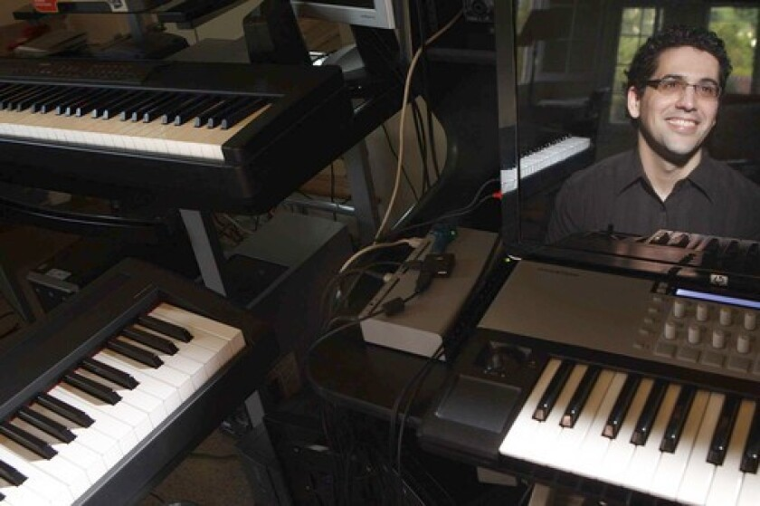 """COMPOSER: """"My style changes constantly, and I think that's a sign of our times,"""" says Dorman, reflected in a computer."""