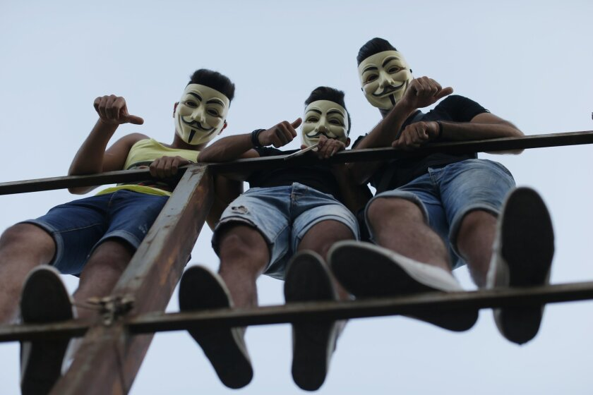 Lebanese anti-government protesters react during a demonstration against the on-going trash crisis and government corruption, in downtown Beirut, Lebanon, Saturday, Aug. 29, 2015. Thousands of people began gathering Saturday amid tight security in downtown Beirut, ahead of a major rally to protest government corruption and the country's dysfunctional political system. (AP Photo/Hassan Ammar)