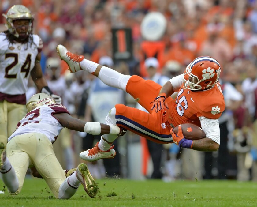 Clemson's Jordan Leggett, right, is tripped up by Florida State's Lamarcus Brutus during the first half of an NCAA college football game, Saturday, Nov. 7, 2015,  in Clemson,  S.C.  (AP Photo/Richard Shiro)