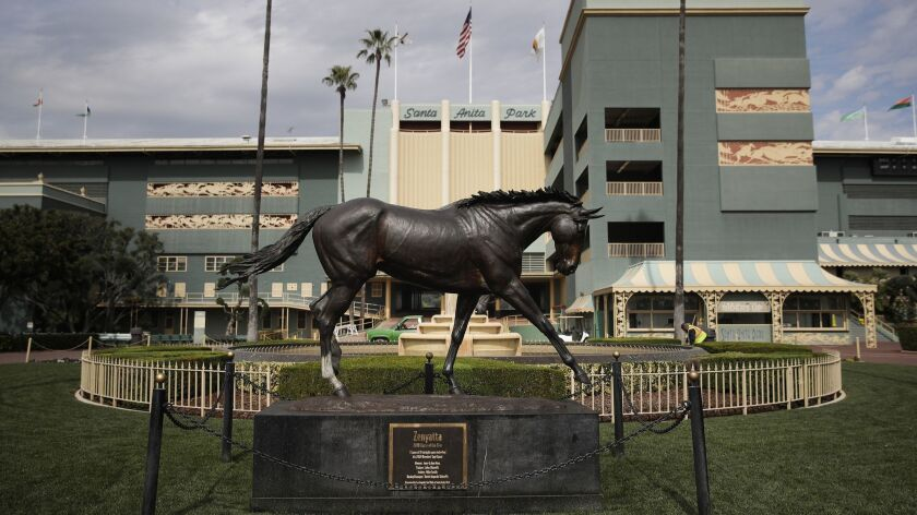 FILE - In this March 5, 2019, file photo, A statue of Zenyatta stands in the paddock gardens area at