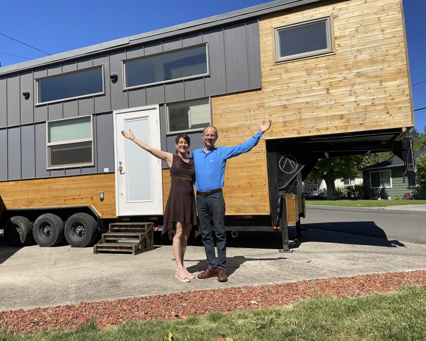 Lindsay and Eric Wood, founders of Experience Tiny Homes of San Diego, in front of their home. They will speak at TinyFest.