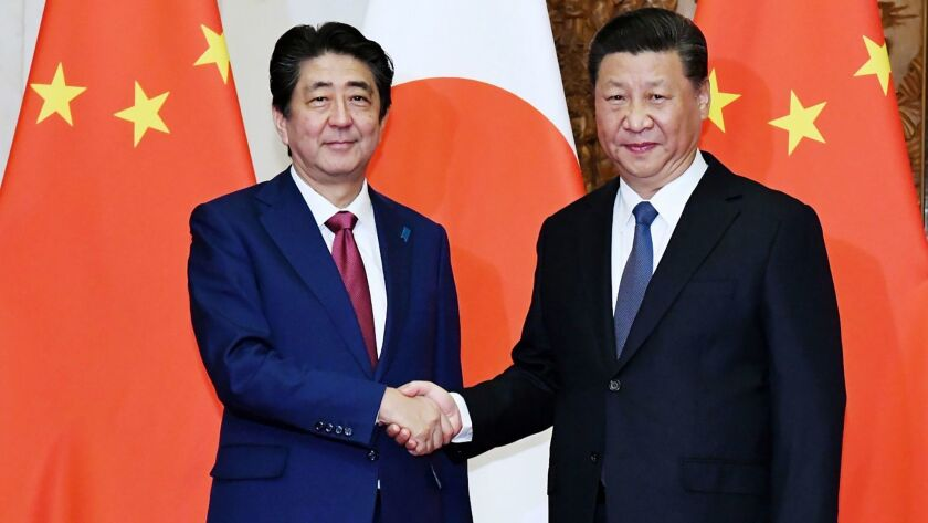 Japanese Prime Minister Shinzo Abe, left, and Chinese President Xi Jinping during their meeting in Beijing on Oct. 26.