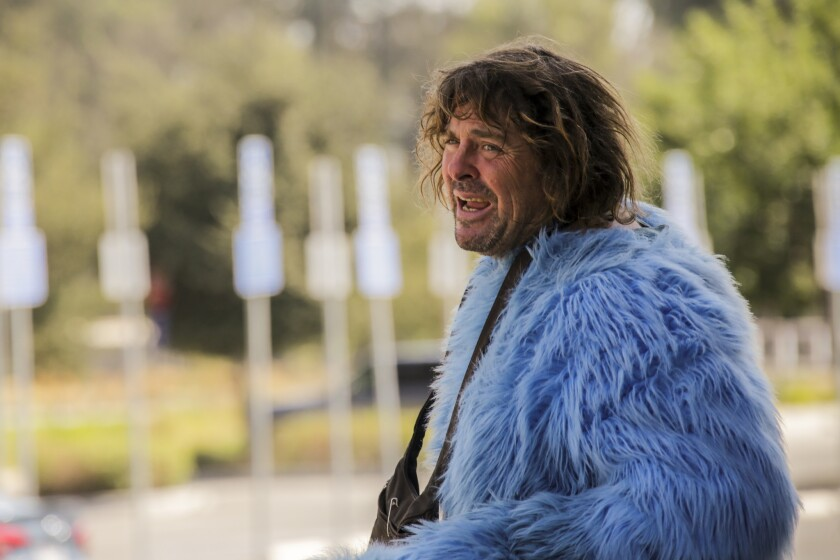 Adam Sandler without his Cookie Monster costume head outside the Los Angeles Zoo.
