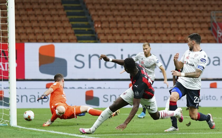 Milan's Rafael Leao (17) scores a goal against Cagliari during a Serie A soccer match at the Giuseppe Meazza stadium in Milan, Italy, Saturday, Aug. 1, 2020. (Spada/LaPresse via AP)