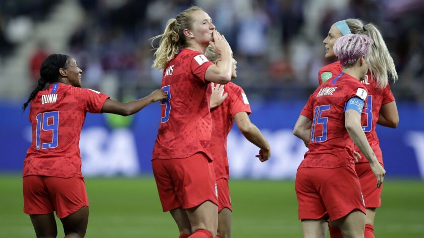 United States' scorer Samantha Mewis, center, and her teammates celebrate their side's 4rth goal dur