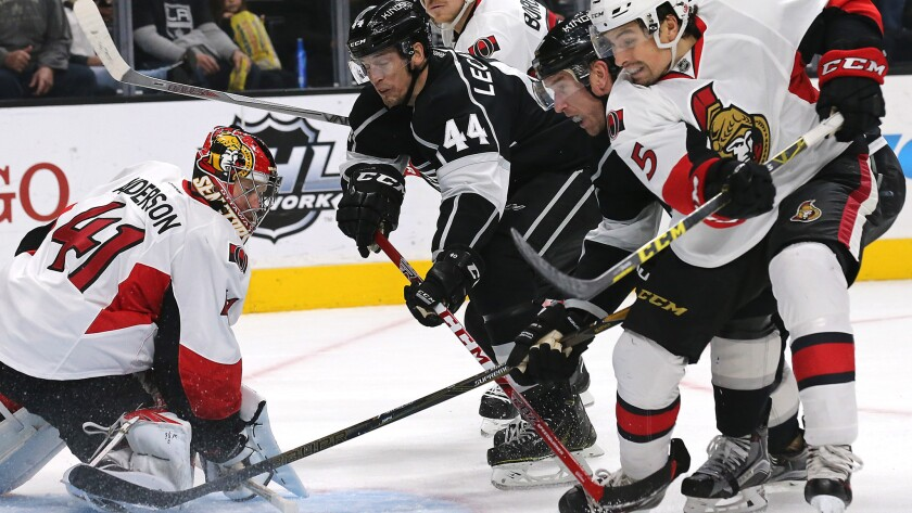 Kings forwards Vincent LeCavalier (44) and Jeff Carter, next to Senators defensman Cody Ceci (5) look for a rebound after Ottawa goalie Craig Anderson made a save Saturday night.
