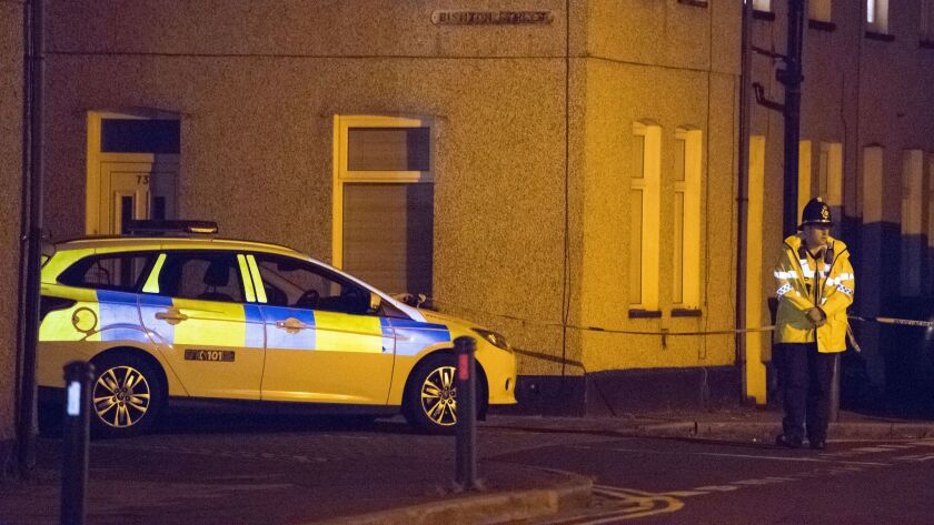 Police cordon off Jeffery Street in Newport, Wales, on Tuesday. Scotland Yard said that a 25-year-old man was arrested in Newport, the third arrest related to Friday's subway attack in Parsons Green.