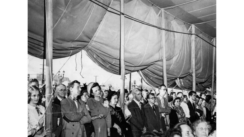 Oct. 30, 1949: Overflow crowd at large tent waiting to hear Dr. Billy Graham speak.