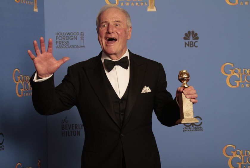 "Jerry Weintraub brandishes a statuette backstage at the Golden Globes in 2014, after his Liberace biopic ""Behind the Candelabra"" won the award for movie or miniseries."