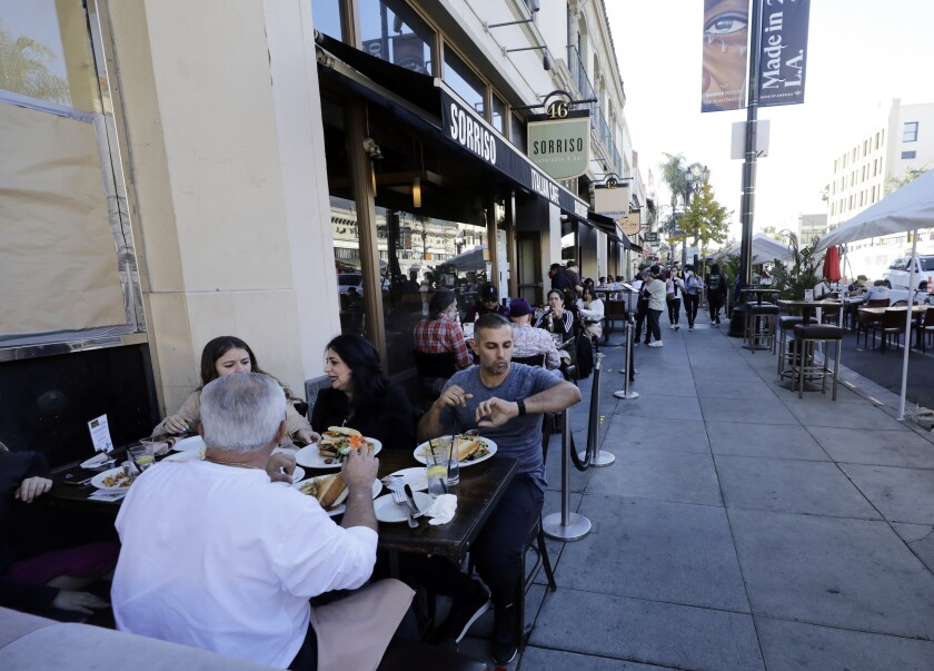 Visitors to Old Pasadena dine outdoors along Colorado Boulevard on Sunday, Nov. 29.