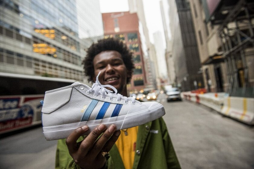 Na-Kel Smith holds one of the Adidas sneakers from his new collaboration with the sneaker brand.