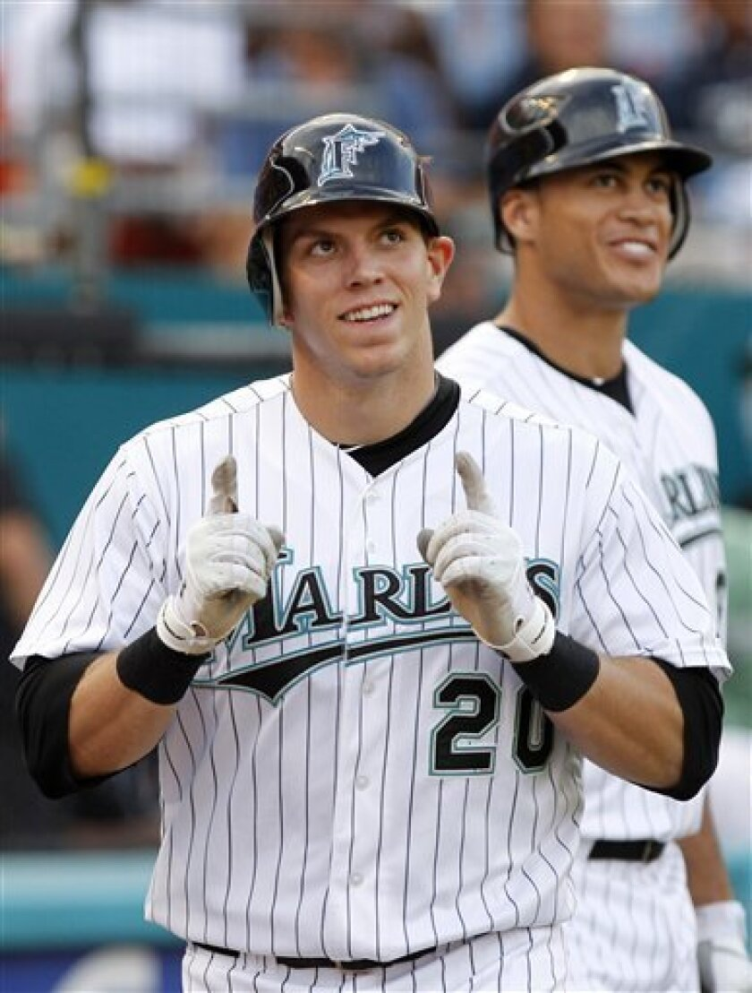 Florida Marlins' Logan Morrison (20) reacts after scoring on his two-run home run, while teammate Mike Stanton, back right, looks on during the first inning of a baseball game against the Arizona Diamondbacks, Friday, June 10, 2011, in Miami. (AP Photo/Lynne Sladky)