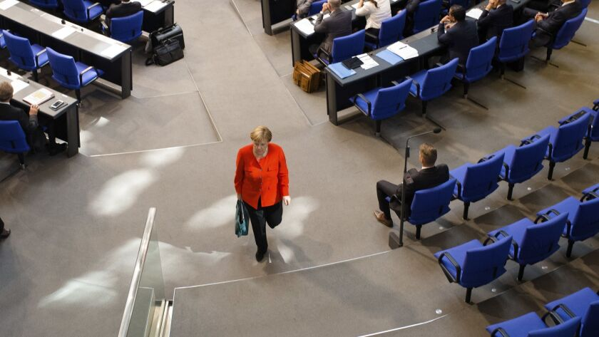 German Chancellor Angela Merkel leaves the plenary session of the German parliament Bundestag about