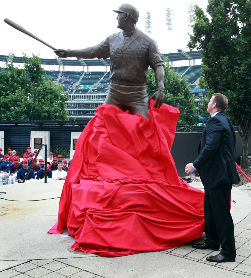 Former Cleveland Indian Jim Thome unveils a statue dedicated to him inside Progressive Field prior to an Indians baseball game against the Texas Rangers, Saturday, Aug. 2, 2014, in Cleveland. (AP Photo/Aaron Josefczyk)