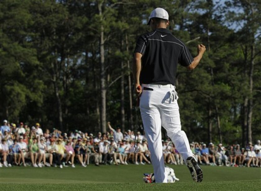 Anthony Kim punches the air after saving par on the 18th hole during the final round of the Masters golf tournament in Augusta, Ga., Sunday, April 11, 2010. (AP Photo/David J. Phillip)