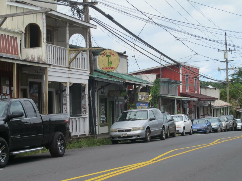 This Sept. 8, 2014 photo shows downtown Pahoa, Hawaii. Surf shop co-owner Tiffany Edwards Hunt said there's a threat Pahoa could become a ghost town if lava from Kilauea volcano crosses roads connecting the village with the rest of the Big Island. (AP Photo/Audrey McAvoy)