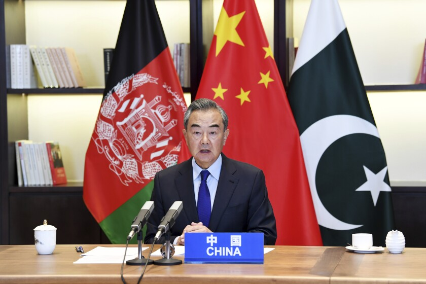 In this photo released by Xinhua News Agency, Chinese Foreign Minister Wang Yi hosts the 4th China-Afghanistan-Pakistan Foreign Ministers' Dialogue via video conference from Guiyang, southwestern China's Guizhou Province Thursday, June 3, 2021. China is urging closer security and economic cooperation with Afghanistan in an apparent effort to bolster its influence in the region as the U.S. and its allies prepare to withdraw their forces from the country. (Yang Wenbin/Xinhua via AP)
