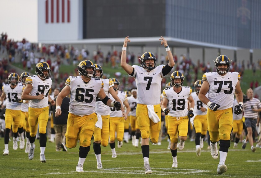Iowa quarterback Spencer Petras (7) along with his team celebrate their 27-17 win over Iowa State in an NCAA college football game, Tuesday, Jan. 16, 2018, in Ames, Iowa. (AP Photo/Matthew Putney)