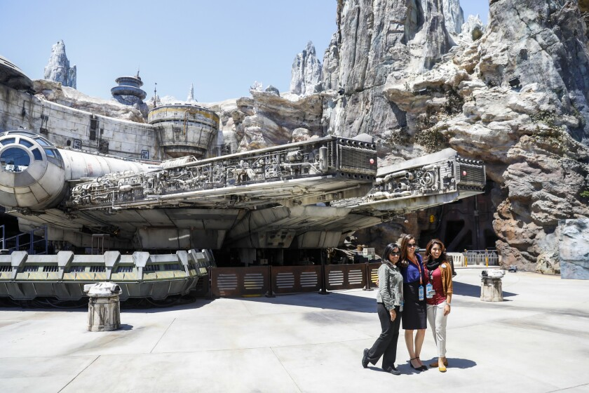 ANAHEIM, CA--MAY 29, 2019--Disneyland Resort cast members pose for a photo in front of The Millenniu