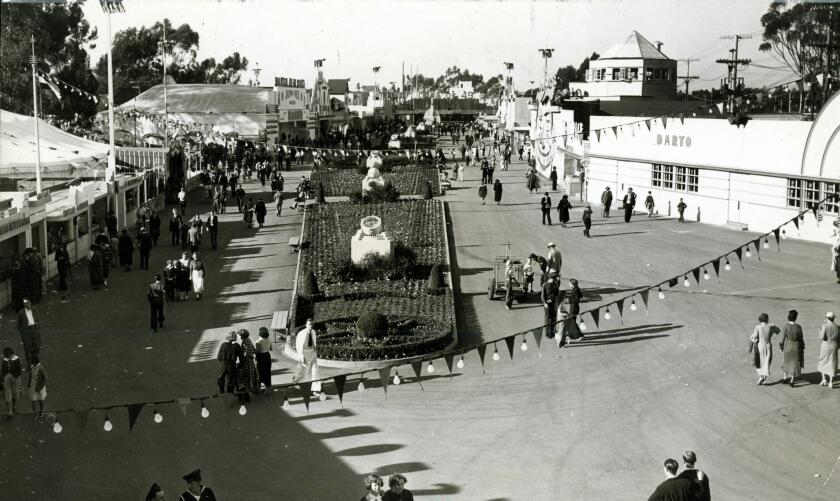 Patrons stroll along the midway of the California Pacific International Exposition in 1935.