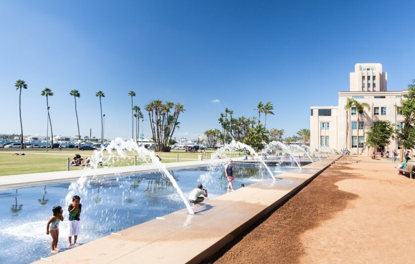 Children play at water park outside of the San Diego County Administration Building