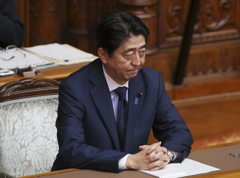 Japanese Prime Minister Shinzo Abe attends the upper house plenary diet session in Tokyo Friday, Sept. 18, 2015 after a censure motion against him was filed by an opposition party in their attempt to block contentious security bills that Abe's ruling party is eager to get final approval by the upper house. The bills would ease restrictions on what the military can do, a highly sensitive issue in a country where many take pride in the postwar pacifist constitution. (AP Photo/Koji Sasahara)