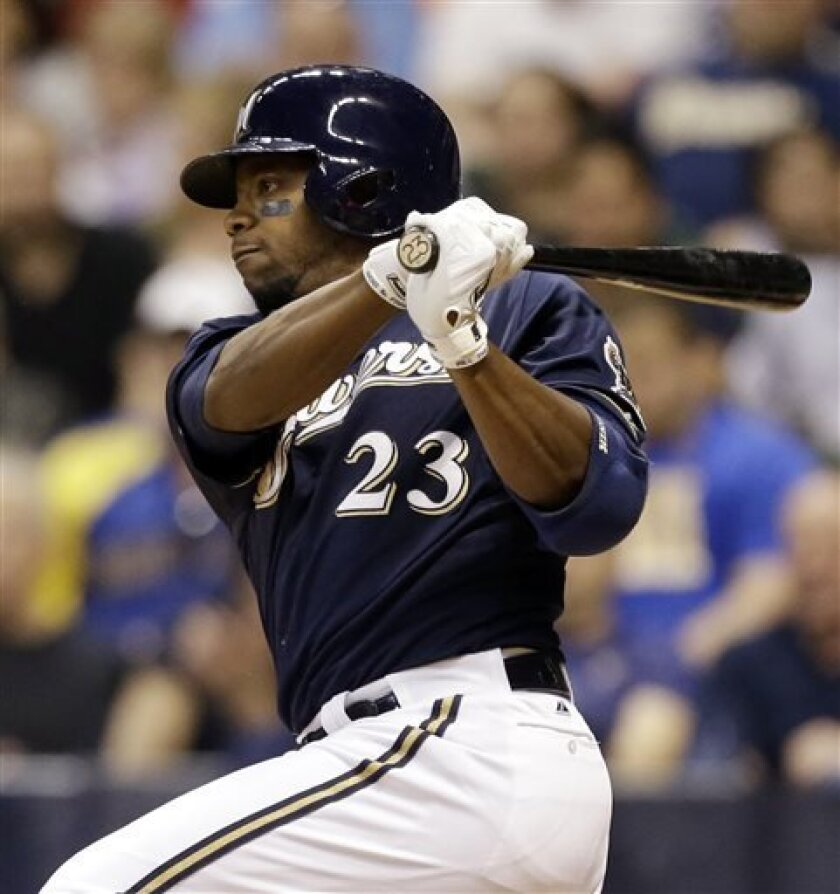 Milwaukee Brewers' Rickie Weeks watches his two-RBI double against Pittsburgh Pirates' James McDonald during the fourth inning of a baseball game, Tuesday, April 30, 2013, in Milwaukee. (AP Photo/Jeffrey Phelps)