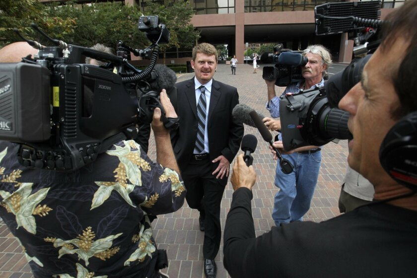 """Cyclist Floyd Landis left the Federal courthouse in San Diego Friday, Aug. 24, after agreeing to a """"deferred prosecution"""" with the government. With him was his attorney, Leo Cunningham."""