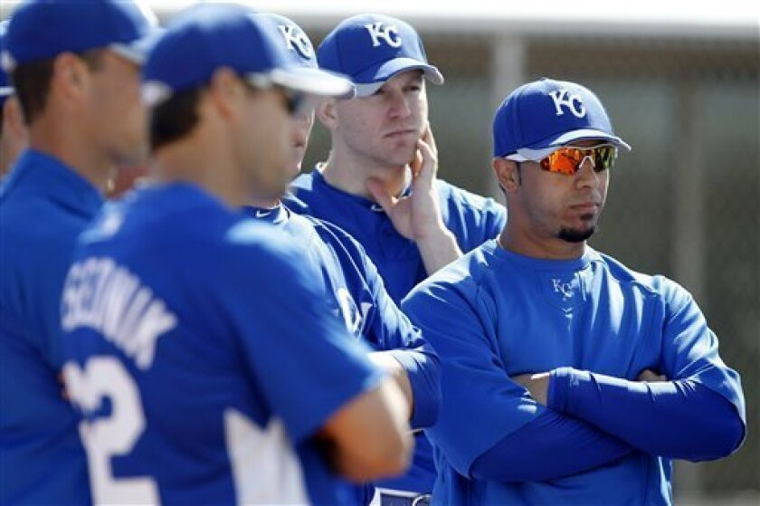 Kansas City Royals shortstop Mike Aviles, right, stands with teammates during a baseball spring training practice, Friday, Feb. 26, 2010, in Surprise, Ariz. (AP Photo/Charlie Neibergall)