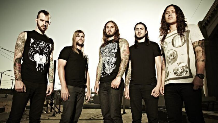 "Tim Lambesis, center, with his band ""As I Lay Dying."" Credit:asilaydying.com"