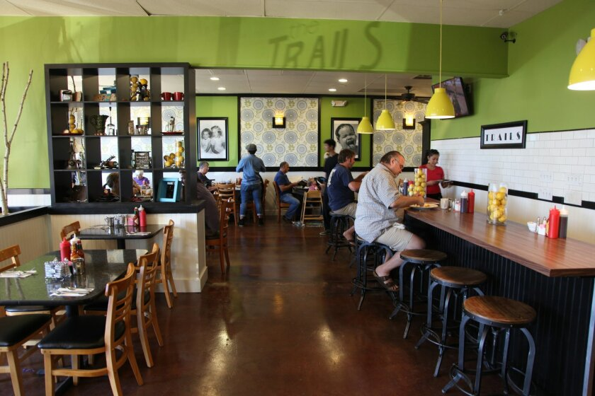 """The Trails Neighborhood Eatery of """"Restaurant: Impossible"""" fame reopened in San Carlos Friday, seven weeks after a catastrophic flood shut it down. Even during the soft opening, customers nearly filled the dining room."""
