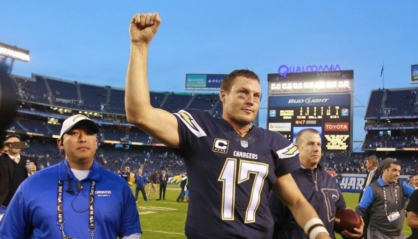 Chargers quarterback Philip Rivers salutes the fans after Sunday's game.