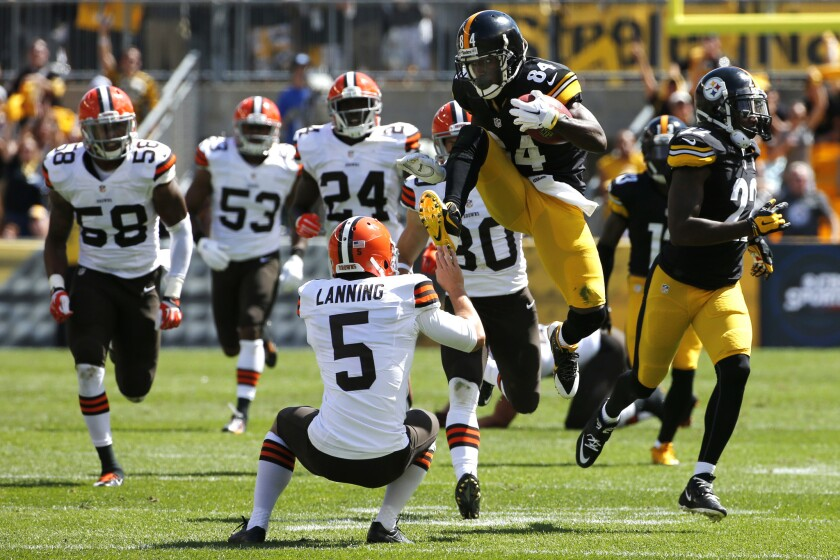 Pittsburgh punt returner Antonio Brown kicks Cleveland punter Spencer Lanning during Sunday's game.